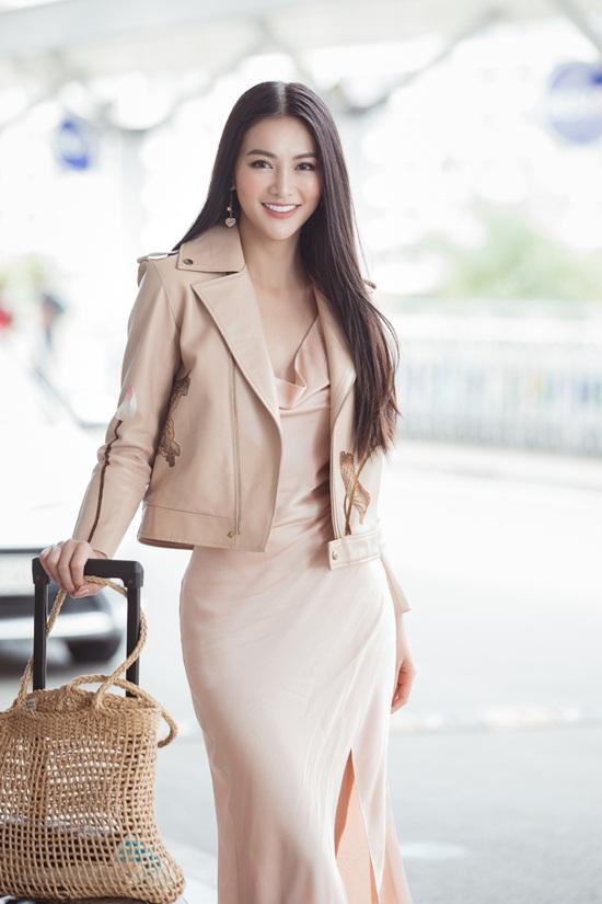 Phương Khánh khoe nhan sắc nữ thần khi lên đường chấm thi quốc tế - Ảnh 1